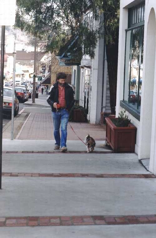 A local character walking his dog downtown just north of courthouse park